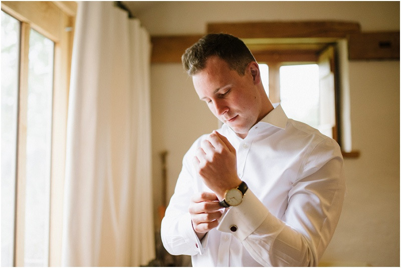 An Autumn wedding at Dewsall Court with Cymbeline Paris dress groom getting ready in Ted Baker suit