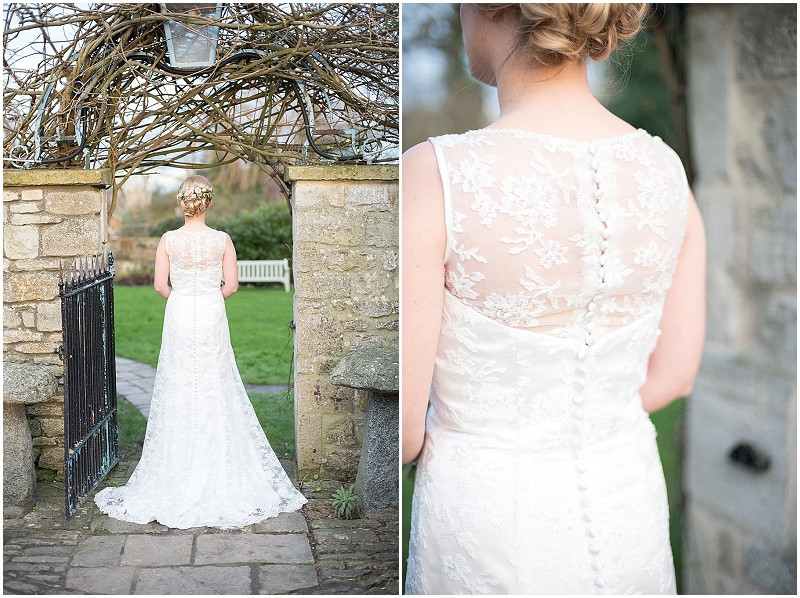 Long lace wedding dress and flowers in brides hair in winter wedding at The Moonraker