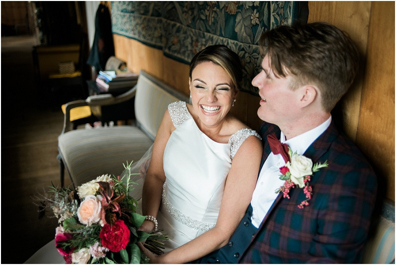 Bride laughing at laid back wedding at Hilles House Stroud by Cotswolds wedding photographer