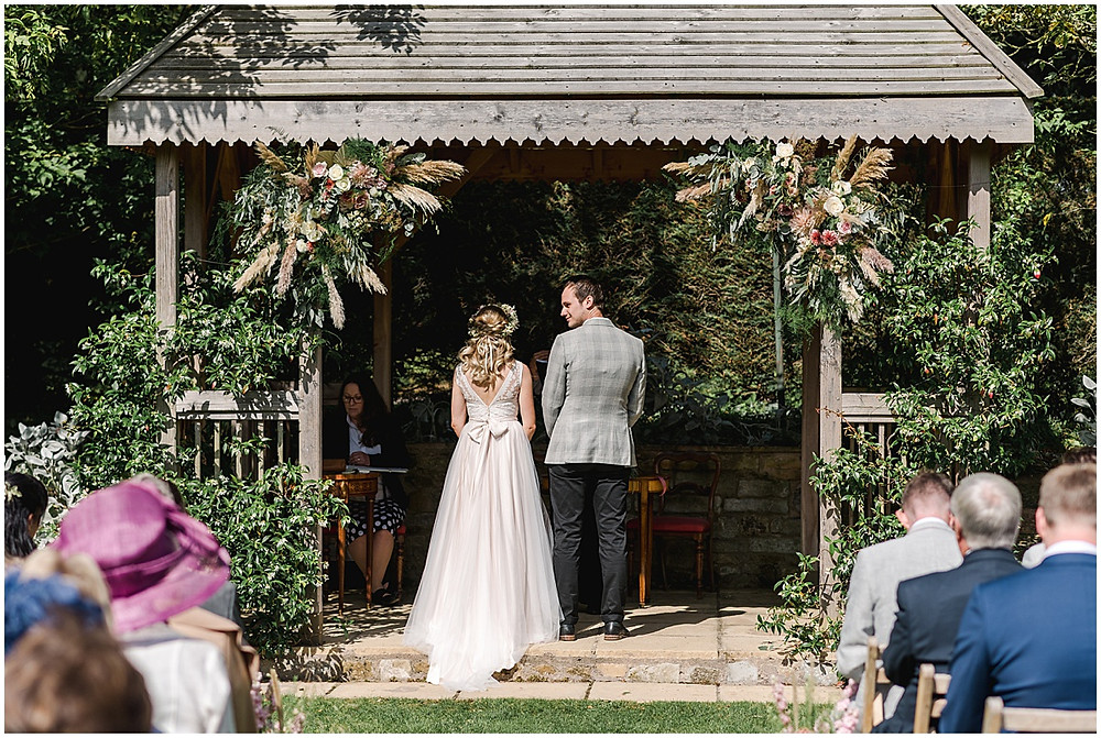 Find lots of luxury wedding inspiration in this dreamy bohemian summer wedding from a Pennard House Wedding Photographer with a beautiful floral outdoor ceremony