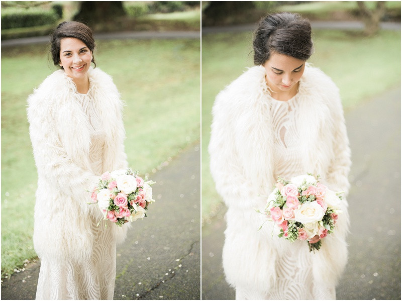 Elegant bride in lace dress and white coat for wedding at Malvern Registry Office