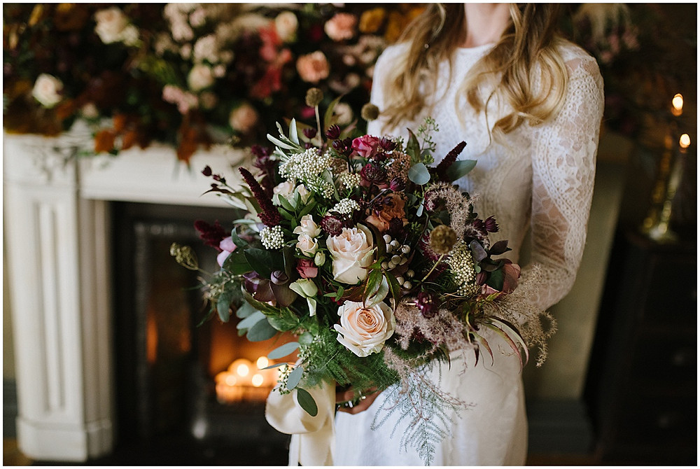 An intimate wedding at luxury wedding venue No131 Cheltenham with florals by Passion for Flowers and a Grace loves Grace dress