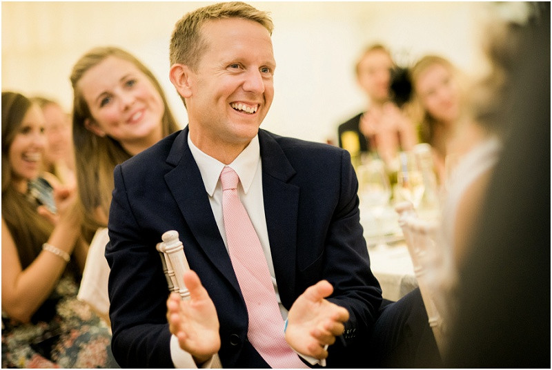 Cotswolds marquee wedding Oxford speeches and guests laughing
