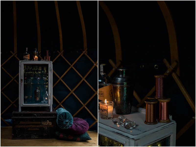 Winter Cotswolds winter wedding styling with wedding yurts in a boho luxe style featuring candles, gold and copper