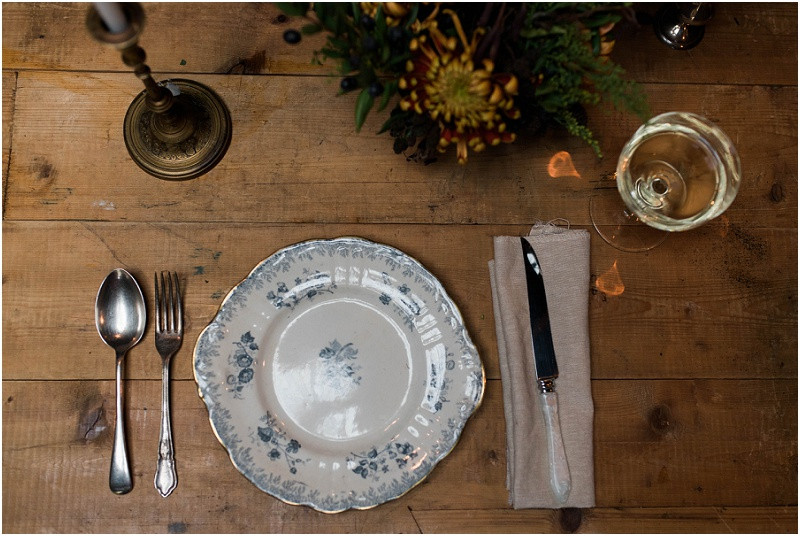 Winter Cotswolds winter wedding styling table styling with candles and winter flowers