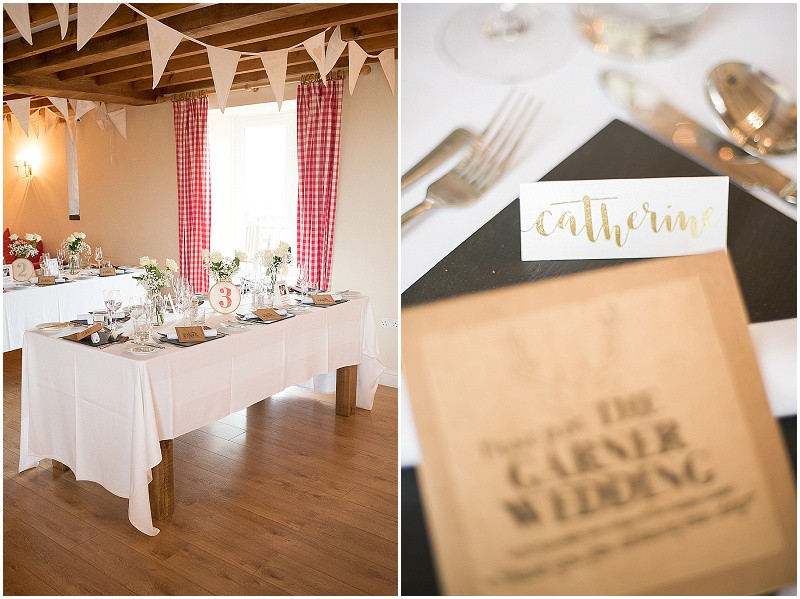 white roses and gold calligraphy for a wedding at The Outbduilding, Anglesey