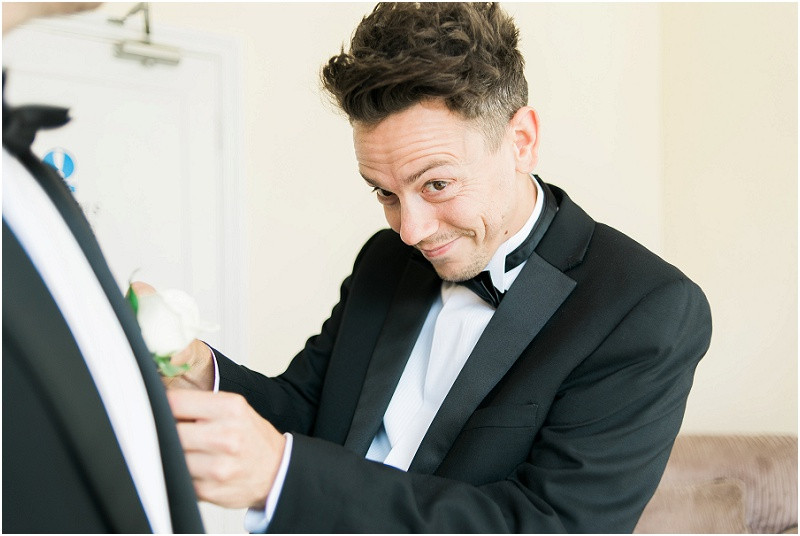 An elegant black tie Cotswolds wedding at Eastington Park with ushers in tuxedos