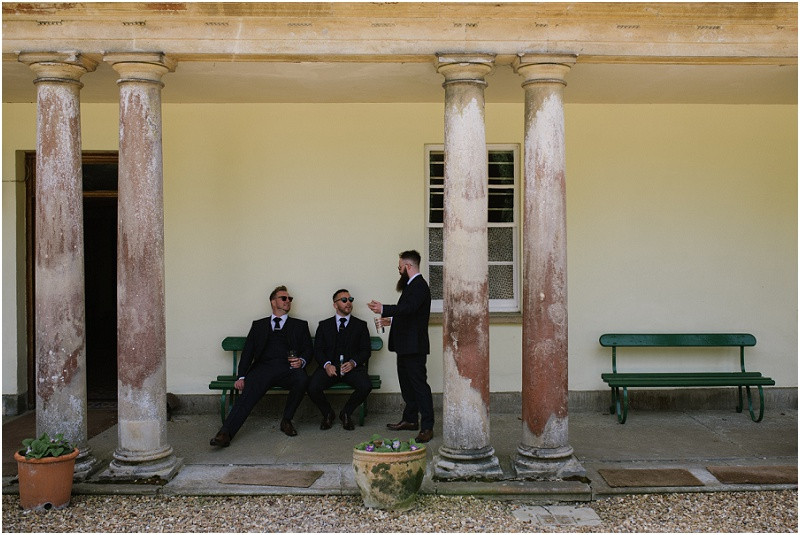 An elegant summer wedding at Pennard house in Somerset groom and ushers getting ready
