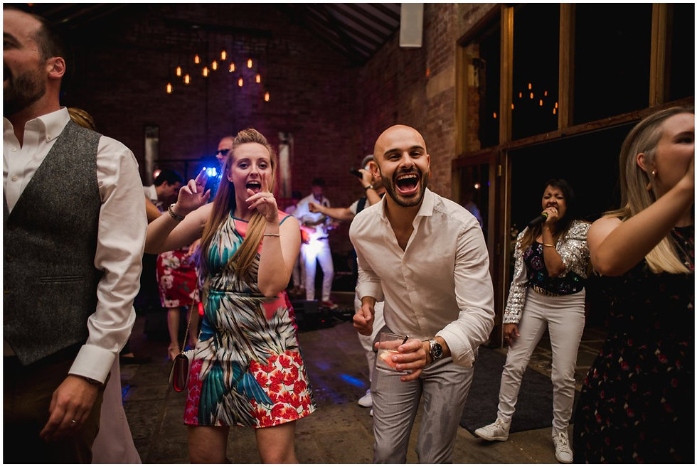 Guests dancing at Mickleton Hills Farm wedding venue