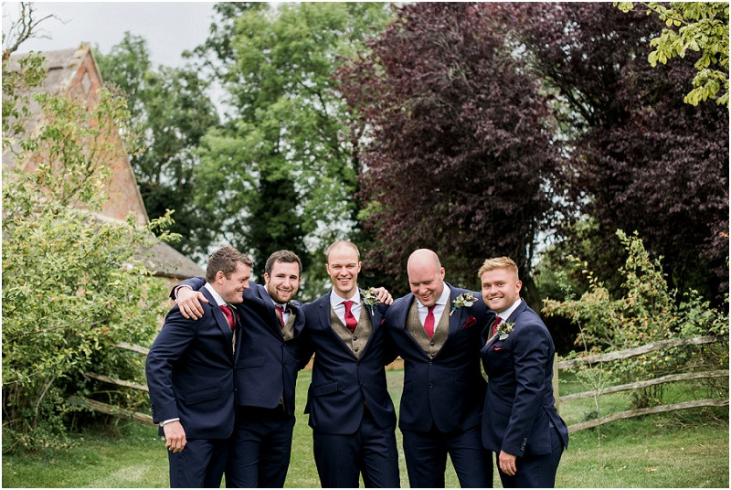 Groom and ushers in navy suits at Blackwell Grange Cotswolds wedding venue