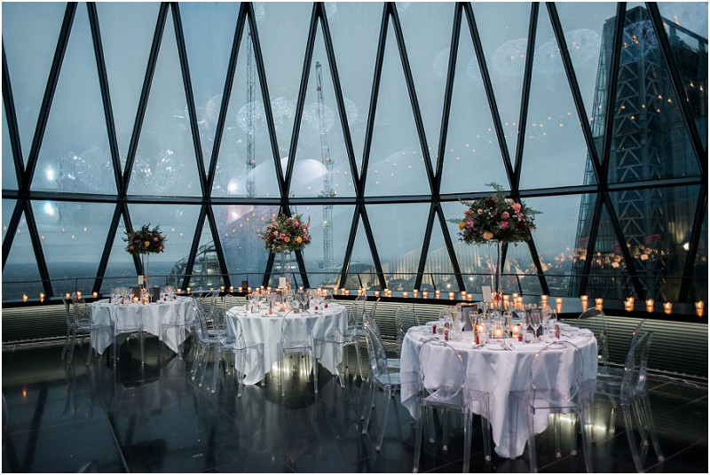 Elegant wedding at The Gherkin London full of candles and flowers