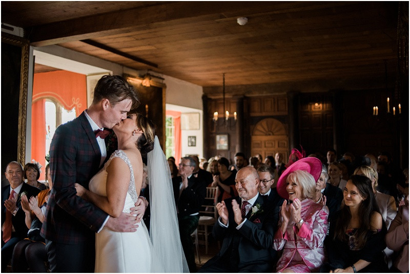 Bride and groom kiss after ceremony at laid back wedding at Hilles House Stroud by Cotswolds wedding photographer