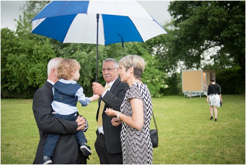 Boho tipi wedding Peak tipis Nottinghamshire guests in the rain