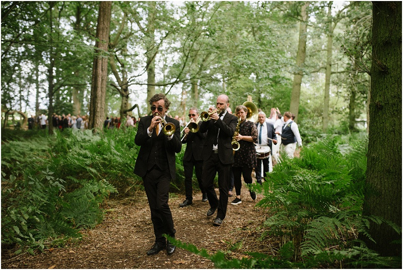 From your wedding photos to your wedding venue, entertainment and flowers, check out these five steps to plan your dream relaxed Gloucestershire wedding. Ceremony brass band at Bluebell wildwood tipi wedding