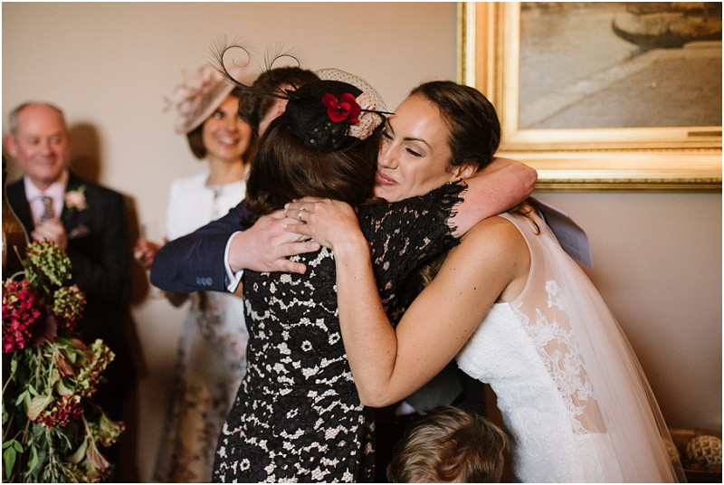 An Autumn wedding at Dewsall Court with Cymbeline Paris dress and Ted Baker navy suit