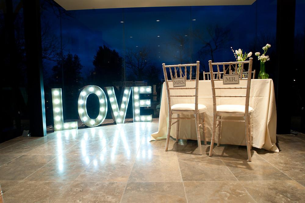 illuminated love sign rustic wedding ceremony