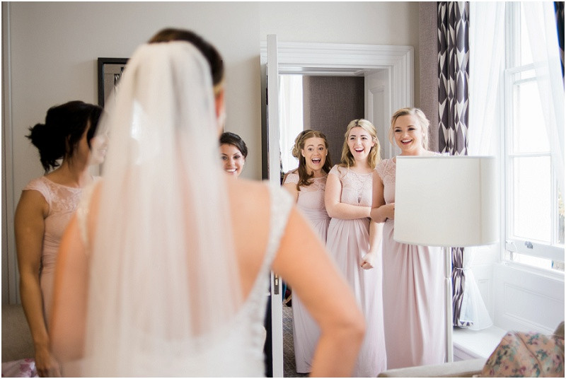 bride getting ready forhilles house cotswolds marquee wedding at Queens hotel Cheltenham