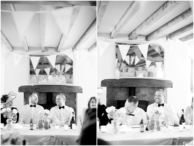 grooms laughing at speeches at The Outbuildings wedding venue, Anglesey