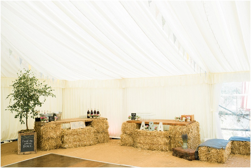 Cotswolds marquee wedding Oxford boho rustic homemade bar with hay bales