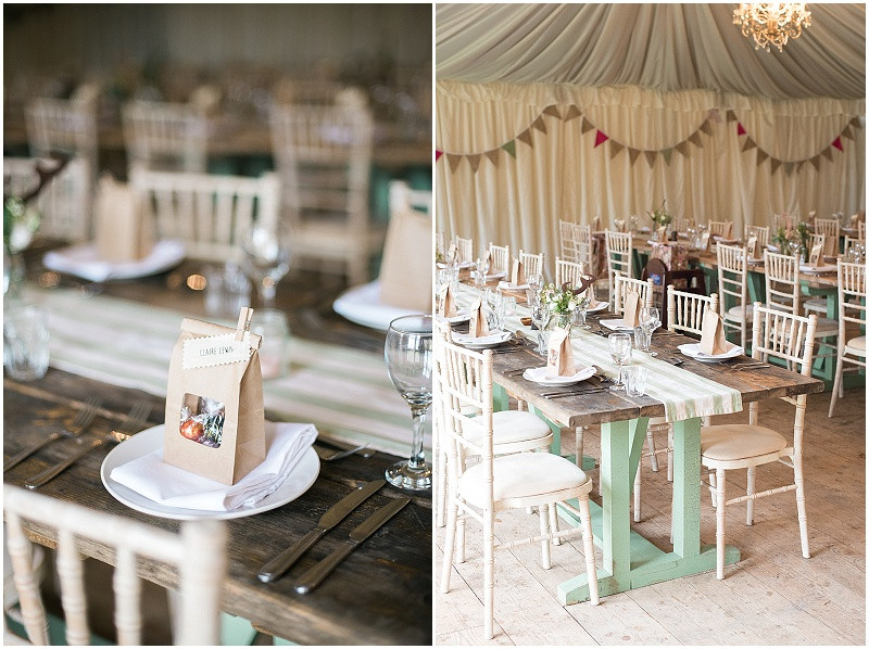 chocolate lindt favours and green and wooden long tables in marquee at The Moonraker winter wedding