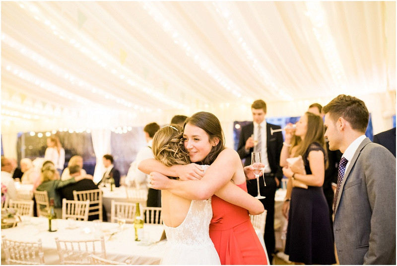 Cotswolds marquee wedding Oxford guests hugging