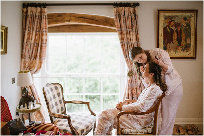 An Autumn wedding at Dewsall Court with Cymbeline Paris dress bride getting ready