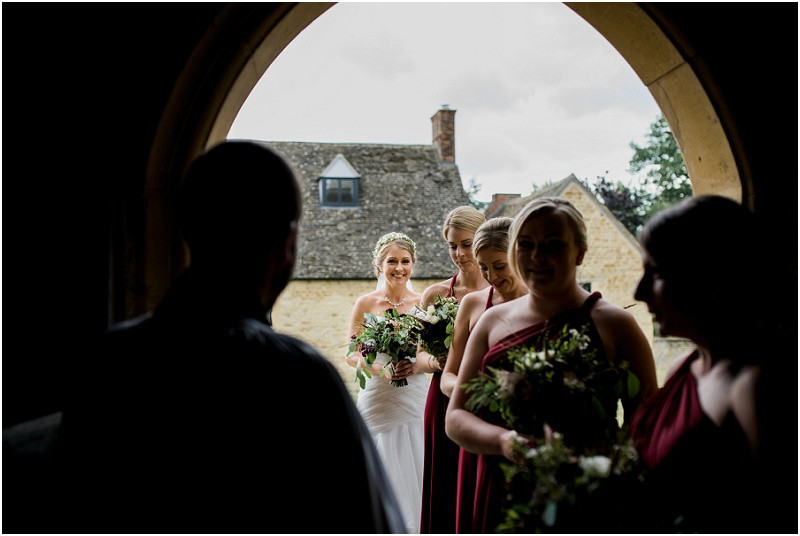 Bride in Essense of Australia and bridesmaids at Cotswolds church wedding
