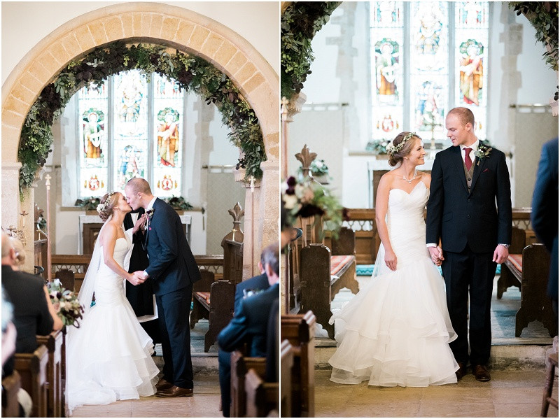 Bride in Essense of Austrlia and flower crown and groom in navy suit at Cotswolds church wedding