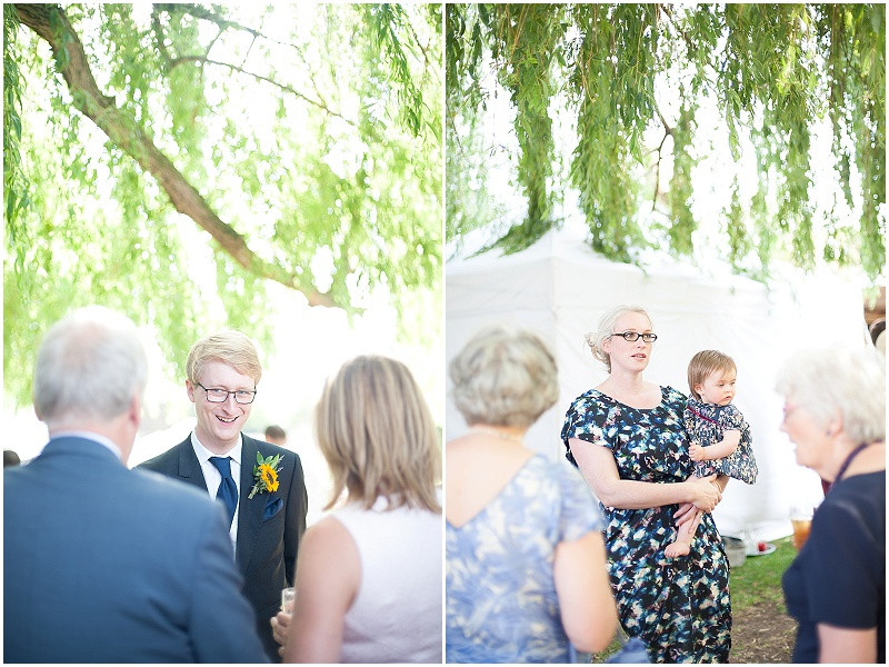 A lace dress, navy bridesmaids and rustic marquee for wedding at The Perch Inn, Oxford