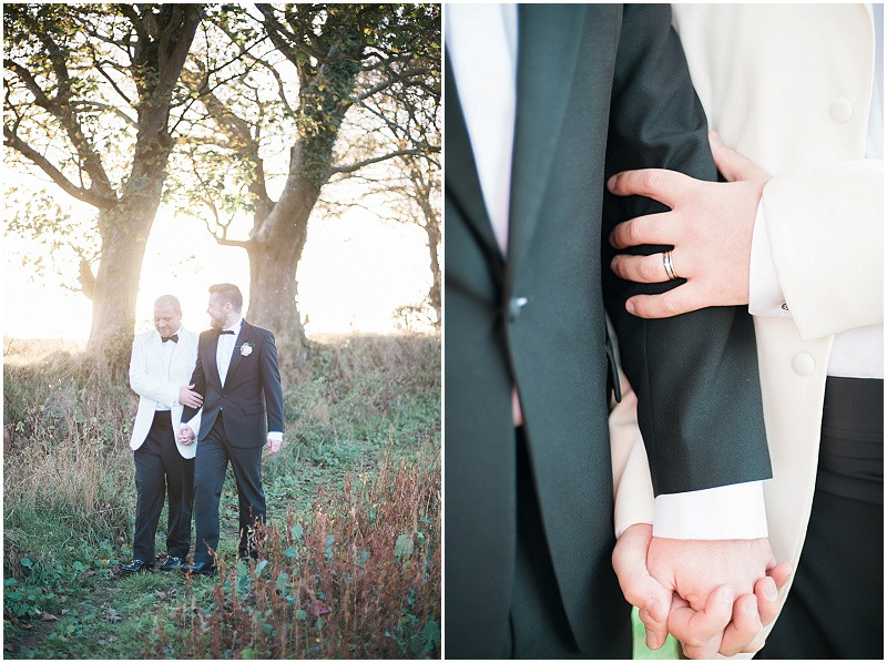 Gay wedding couple wearing black and white tuxedo at The Outbuildings barn, Anglesey
