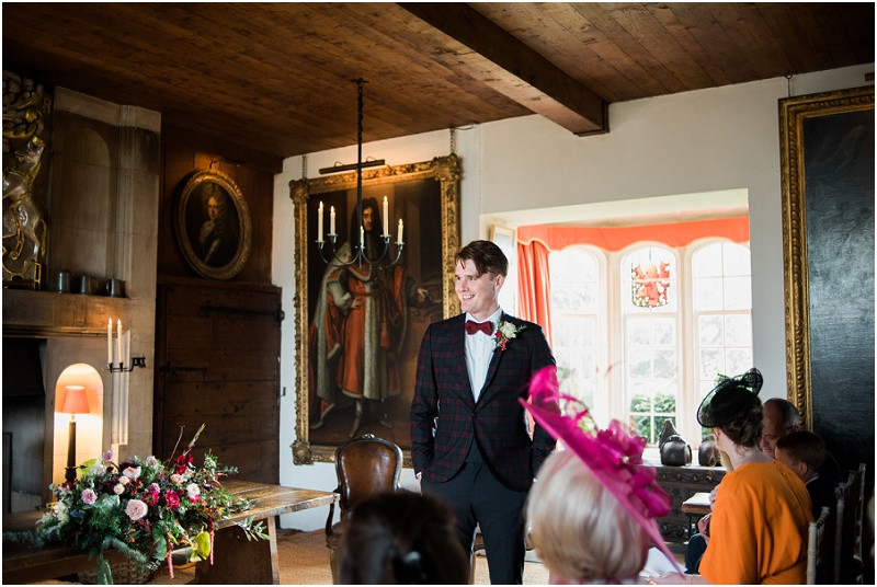 Groom in cheked suit and bow tie at Hilles House Cotswolds wedding venue