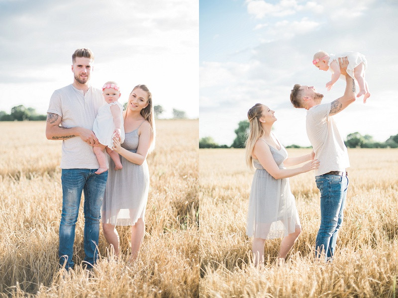 A young family in a field of golden wheat with Cotswolds family photographer