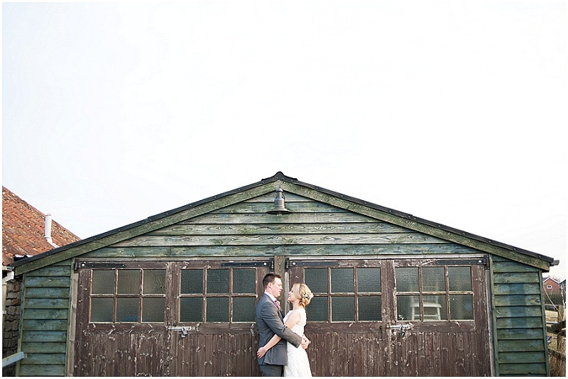 bride and groom by rustic shed at The Moonraker, bradford upon avon
