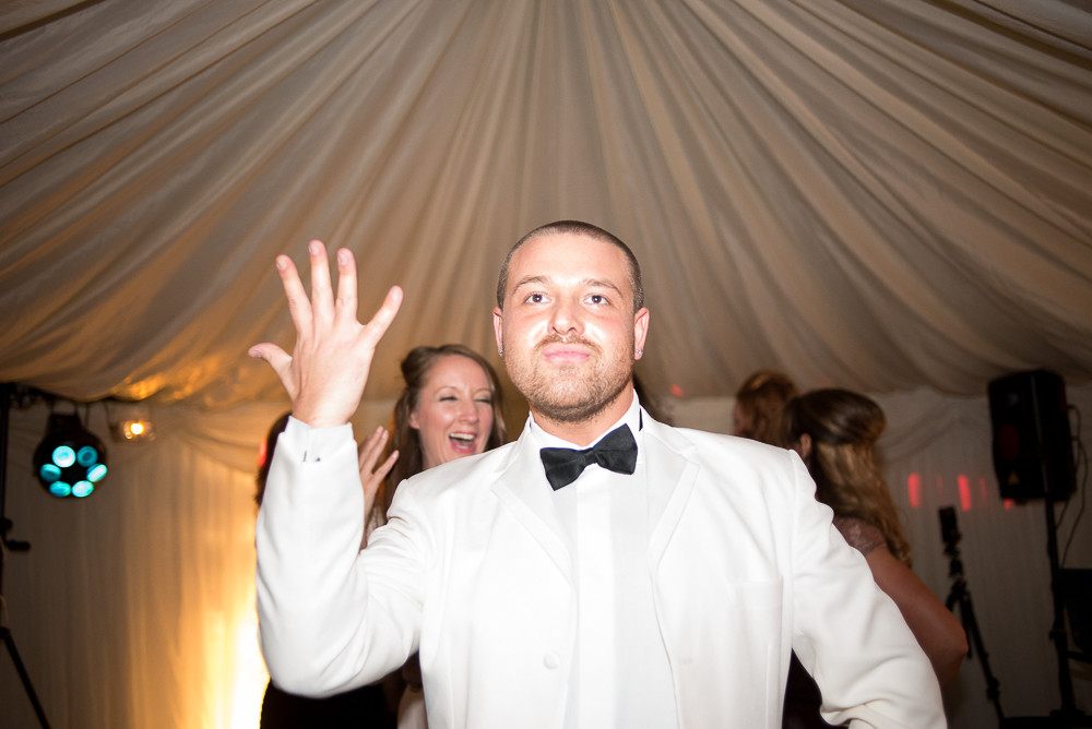 groom dancing at wedding venue The Outbuildings Anglesey