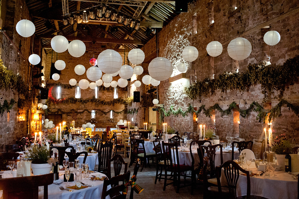 Lyde court barn wedding venue herefordshire with papoer lanterns hanging from ceiling