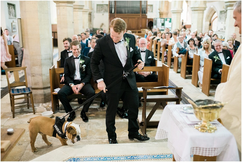 dog ring bearer at Great Tythe Barn Cotswolds wedding venue for a black tie wedding