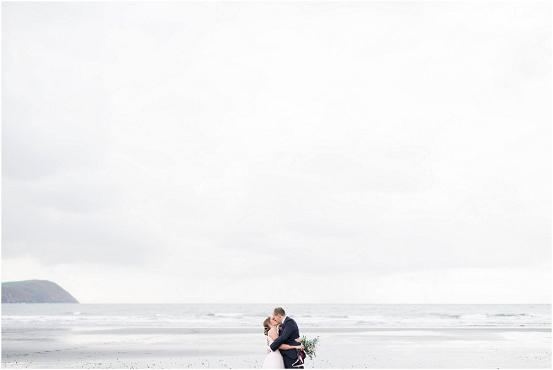 Cotswolds wedding photographer bride and groom on beach wedding in Pembrokeshire