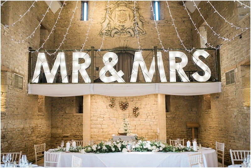 Light up letters at black tie wedding at Great Tythe Barn Cotswolds wedding venue