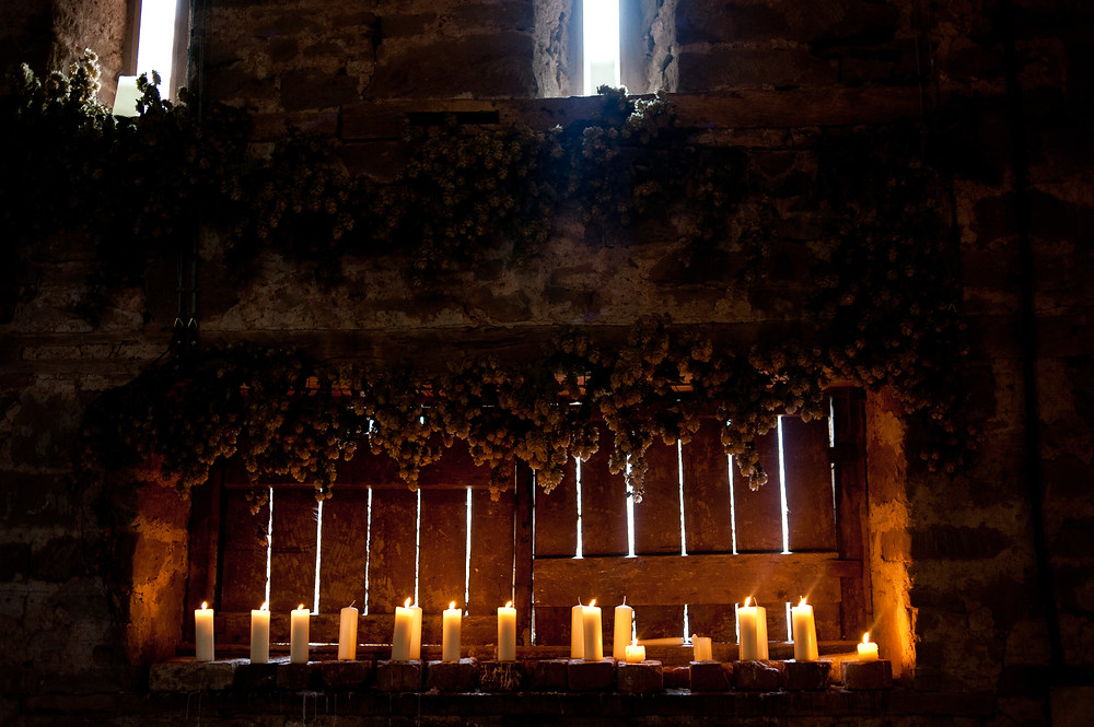 candles and hops at Lyde Court barn Herefordshire