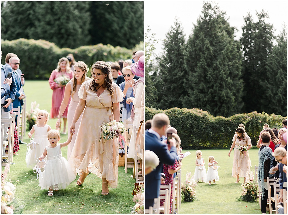 Find lots of luxury wedding inspiration in this dreamy bohemian summer wedding from a Pennard House Wedding Photographer with a beautiful floral outdoor ceremony and bridesmaids in mismatched silk dresses