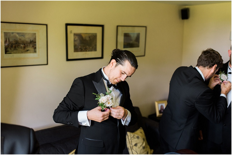 Groom in tuxedo at Great Tythe Barn Cotswolds wedding venue for a black tie wedding