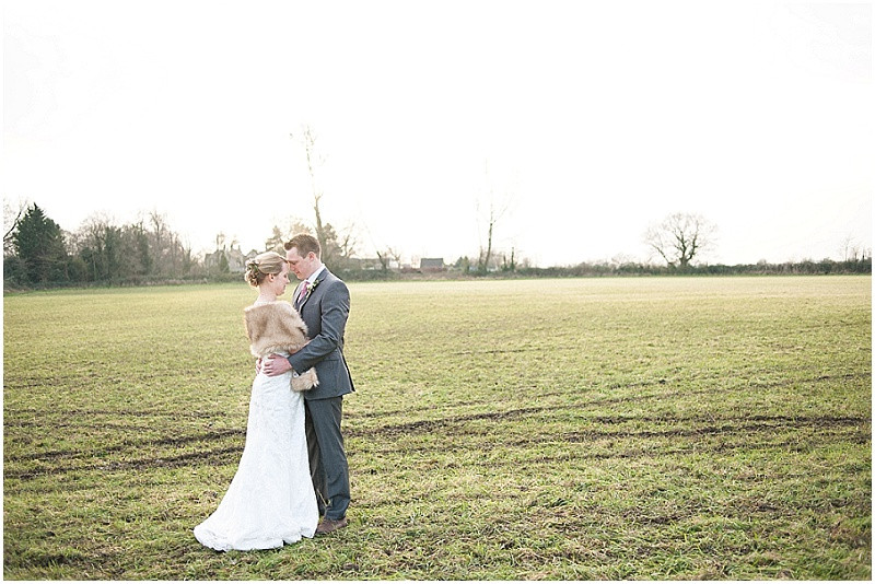 bride and groom portrait in field for winter wedding at The Moonraker, Bradford Upon Avon