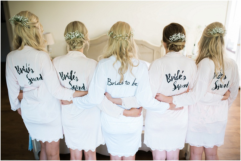 Bridesmaids in dressing gowns at Great Tythe Barn Cotswoldsw wedding venue for a black tie wedding