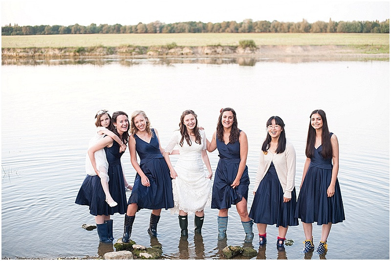 bridesmaids in navy in the river at The perch wedding Oxford