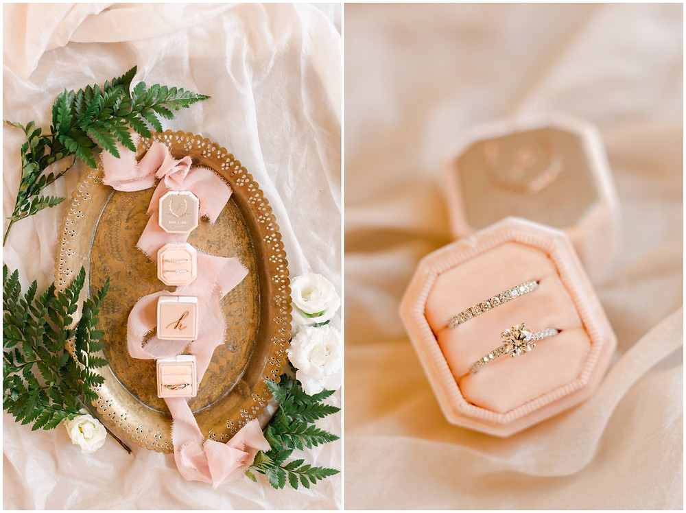 beautiful flat lay of a elegant diamond wedding rings and pink embossed The Mrs Box
