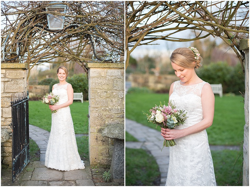 Bride with a lace dress and pink roses bouquet for a winter wedding at The Moonraker Bradford Upon Avon
