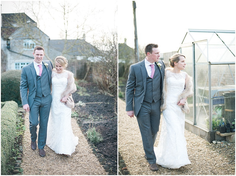 Bride and Groom walking in kitchen garden at winter wedding at The Moonraker Wiltshire