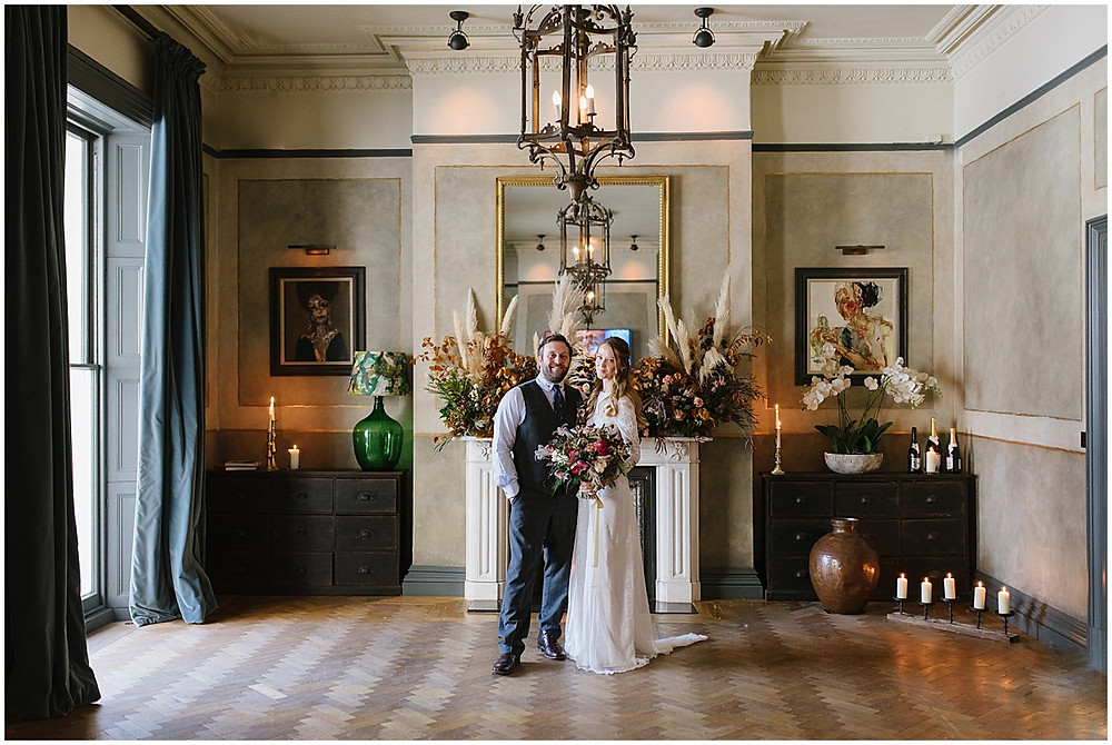 An intimate wedding at luxury wedding venue No131 Cheltenham with pampas grass decor and Autumn weddings