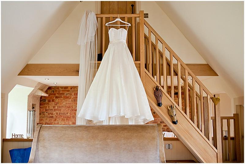 Sassi Holford wedding dress for a stylish wedding at Dodofrd Manor