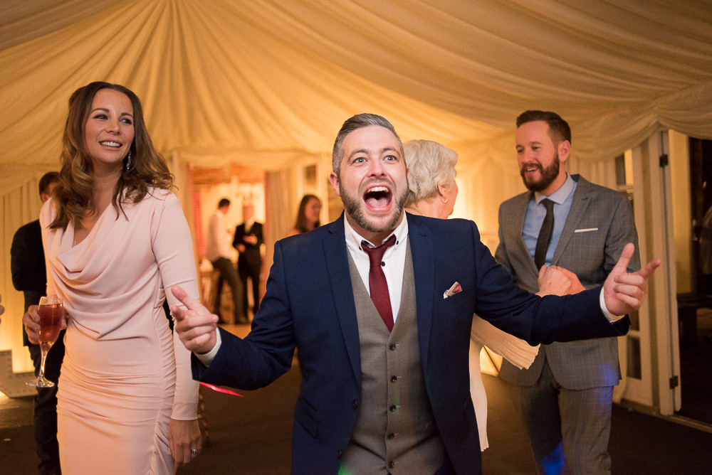 wedding guests dancing at The Outbuildings, Anglesey